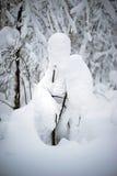 Una deriva de la nieve en la forma de un hombre Foto de archivo