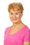 Una donna affascinante sorridente anziana Fotografie Stock Libere da Diritti