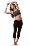 Una donna che allunga i muscoli del corpo Fotografie Stock