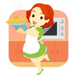 Donna in torta della tenuta della cucina Fotografia Stock