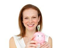 Una donna con un contenitore di soldi Fotografia Stock Libera da Diritti
