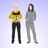 Una donna di due sport con un pallone da calcio Immagini Stock