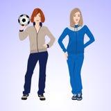 Una donna di due sport con un pallone da calcio Fotografie Stock