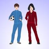 Una donna di due sport con un pallone da calcio Immagini Stock Libere da Diritti