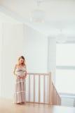 Una donna incinta Immagine Stock