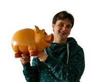 Una donna sta tenendo un porcellino salvadanaio immagine stock libera da diritti