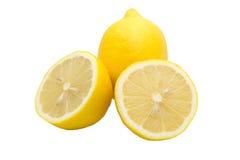 Una e due metà del limone su fondo bianco Fotografia Stock