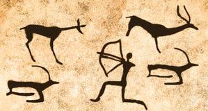 Una escena de la caza para los animales antiguos en la pared de la cueva Fotos de archivo