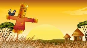 Una estatua y una granja del hombre Imagen de archivo libre de regalías