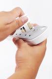 Una extensión del contacto del pugin 3 de la mano Foto de archivo libre de regalías