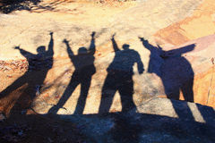 Una famiglia delle ombre felici Fotografie Stock