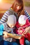 Una famiglia di tre felice Immagini Stock Libere da Diritti