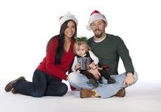 Una familia hermosa joven de la Navidad Fotos de archivo libres de regalías