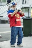 Una fan con una cámara Imagen de archivo