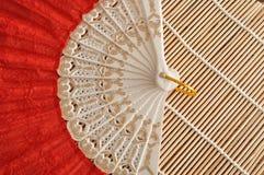 Una fan roja de la mano Fotografía de archivo libre de regalías