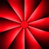 Una fan roja en un fondo oscuro Fotografía de archivo libre de regalías