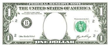Una fattura del dollaro con un foro Fotografia Stock