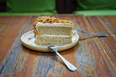 Una fetta di dolce della mandorla del caffè Fotografie Stock