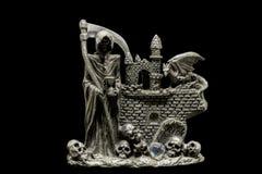 Una figurina del metallo del reaper fotografie stock