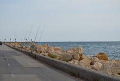 Una fila de cañas de pescar Foto de archivo libre de regalías
