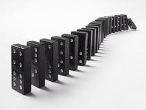Una fila de dominós imagenes de archivo