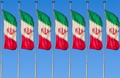 Una fila della bandiera dell'Iran Immagini Stock