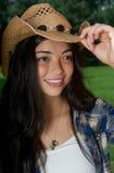 Una fine in su di un cowgirl grazioso Fotografia Stock