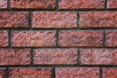 Una fine su di un rosso bricked la parete Struttura Bricky La muratura ha congiunto il fondo Cuciture di un muro di mattoni Blocc fotografia stock libera da diritti
