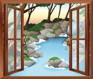 Una finestra vicino alle cascate Immagine Stock