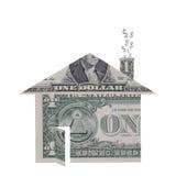 Forma de la casa hecha de billetes de dólar Foto de archivo