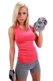 Una foto de una mujer que levanta un peso Imagen de archivo libre de regalías
