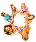 Una foto di sei bambini in una posa del loto Fotografie Stock Libere da Diritti