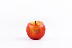 Una frutta della mela su un fondo bianco Fotografie Stock Libere da Diritti