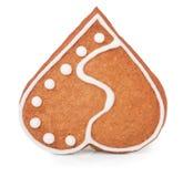 Una galleta en la forma del corazón en el fondo blanco Imagen de archivo