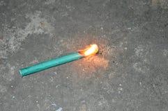 Una galleta en la llama Foto de archivo libre de regalías