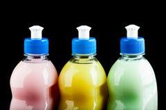 Una gamma di tre superiori differenti delle bottiglie isolata sul nero Fotografie Stock