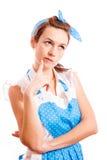 Una giovane casalinga sta ritenendo a qualcosa Fotografie Stock