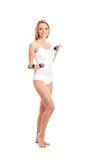 Una giovane donna caucasica bionda su bianco Immagine Stock