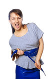 Una giovane donna divertente isolata su un fondo bianco fotografia stock libera da diritti