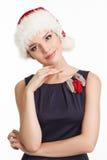 Una giovane donna sorridente in un cappello di Natale Fotografia Stock