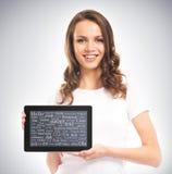 Una giovane e ragazza felice che tiene un computer della compressa Fotografia Stock