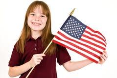 Ragazza che tiene una bandiera americana Fotografia Stock