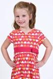 Giovane ragazza caucasica in un vestito dal cuore Fotografia Stock