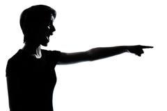 Una giovane ragazza dell'adolescente che indica siluetta di risata Immagine Stock Libera da Diritti