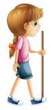 Una giovane signora che fa un'escursione con un bastone Immagini Stock Libere da Diritti