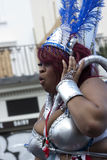 Una grande donna di colore al carnevale del Notting Hill Fotografie Stock Libere da Diritti