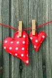 Forme del cuore sulla linea di lavaggio Fotografie Stock