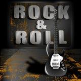 Una guitarra eléctrica en un fondo del metal Foto de archivo libre de regalías