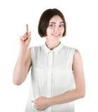 Una hembra hermosa aislada en un fondo blanco Una muchacha que destaca Una señora atractiva en una camisa sport Una mujer alegre Imágenes de archivo libres de regalías