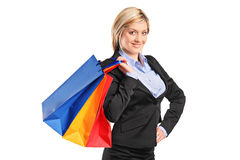 Una hembra joven con los bolsos de compras Imagen de archivo libre de regalías